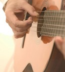 Strumming an Acoustic Guitar 2003