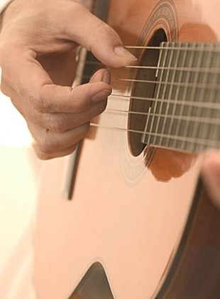 Strumming an Acoustic Guitar 2003